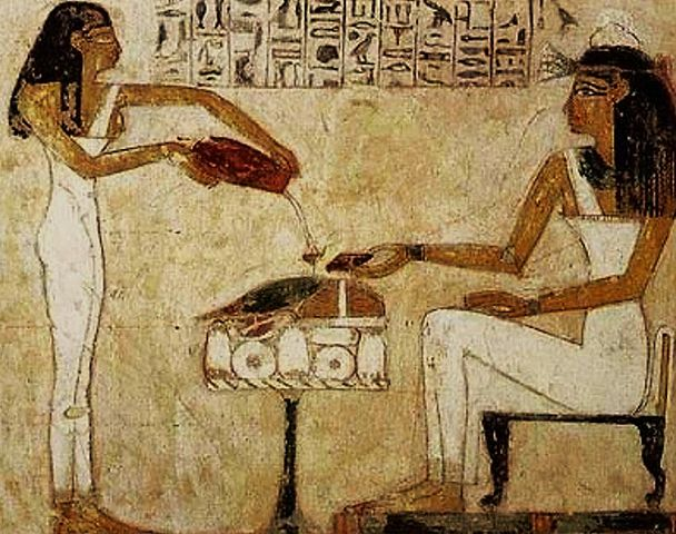Egyptian hieroglyphics depicting the pouring of beer.