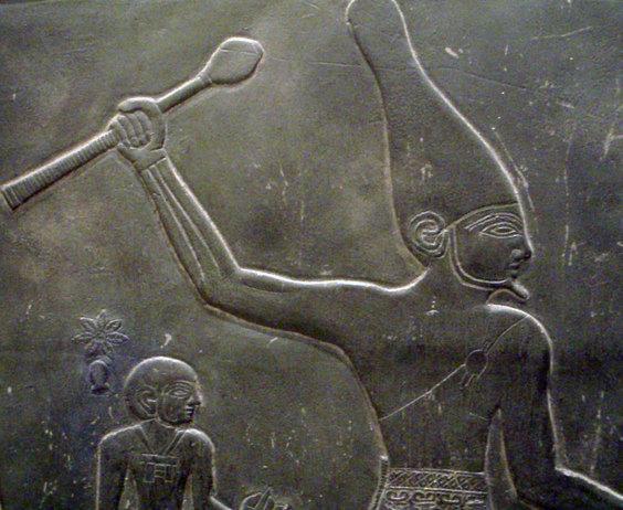 Pharaoh Narmer, holding an Ancient Egyptian Mace.
