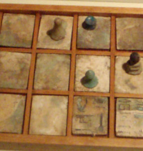 A senet game board and pieces.