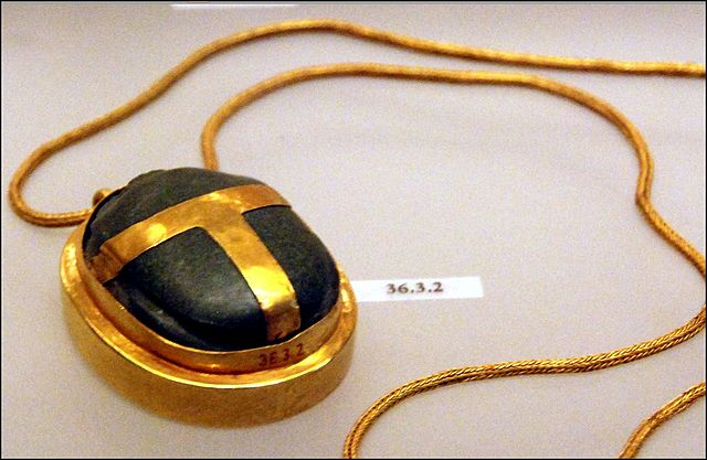 Gold and green stone heart scarab from the 18th dynasty. Found the tomb of Ramose and Hatnofer.
