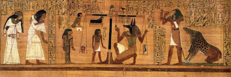 Anubis weighs Ani's heart against the feather of Maat.