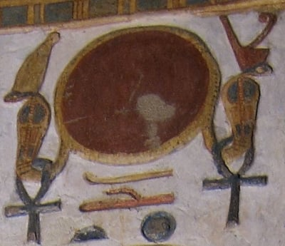 Depiction of Ra's sun-disc encircled by two uraeus cobras.
