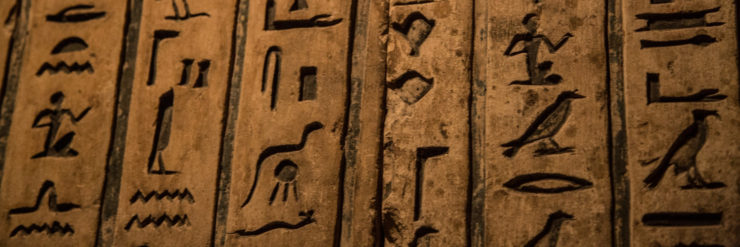 Egyptian hieroglyphs carved into stone.