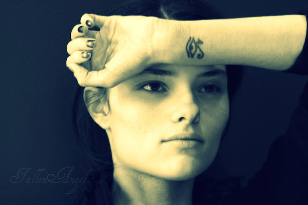 A women with the Eye of Horus tattoo on her inner wrist.