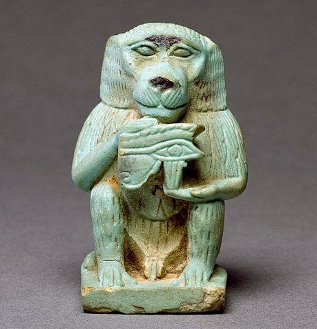 Thoth depicted in Baboon form holds the Eye of Horus.