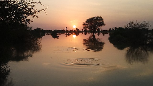 The river nile when it floods and how it shows the reflection at sunset.