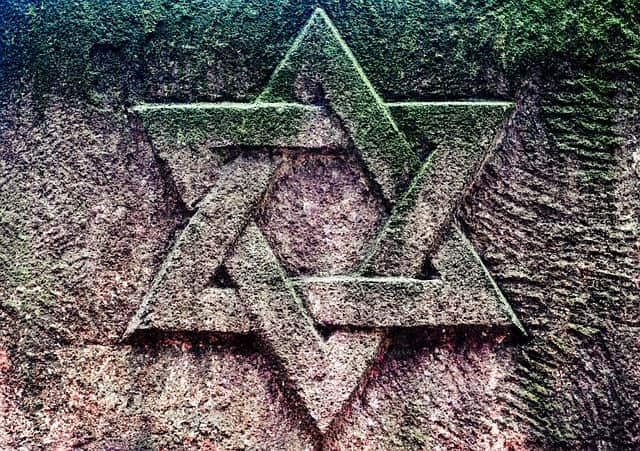 A stone relief of the Star of David, also known as the Shield of David.
