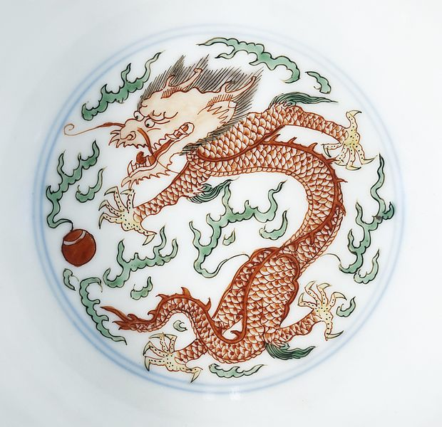 Mystical Pearl Symbol / A porcelain plate depicting a red dragon chasing a mystical pearl.