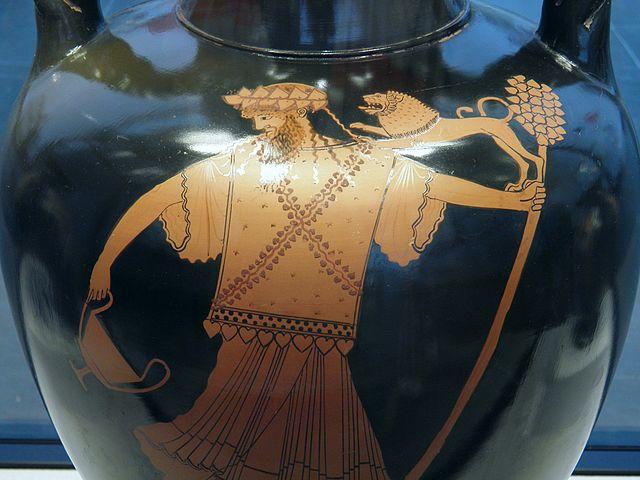 Dionysus holding a thyrsus / Symbol of Dionysus.