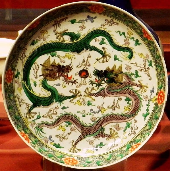 Fuzanglong dragons chasing a flaming pearl on a Qing Dynasty plate.