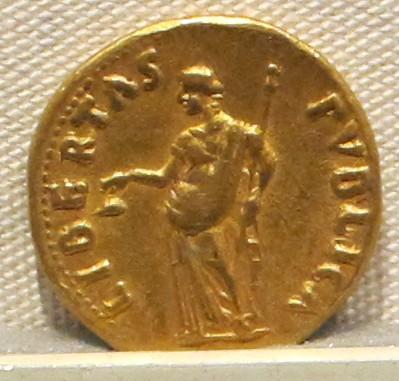 Roman freedom rod / Libertas holding a Vindicta.