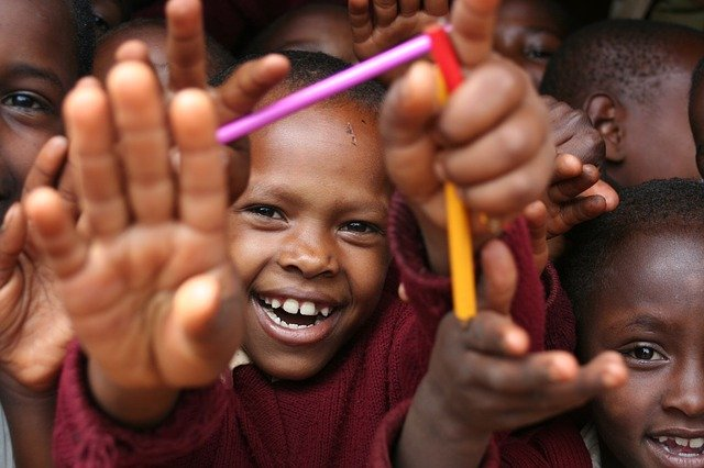Smiling kids / Universal symbol of happiness and joy.