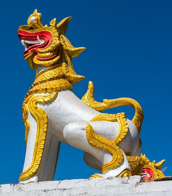 A golden statue of a Suanni dragon on a temple wall.
