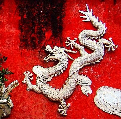 A white dragon on a wall in Haikou, Hainan, China.