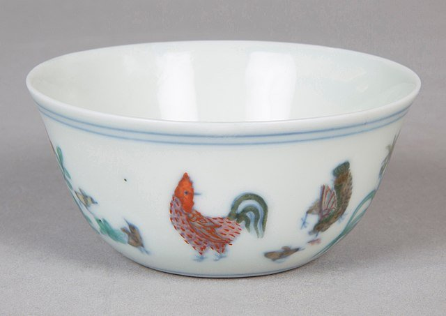 A tiny glazed Ming Dynasty cup depicting a rooster.